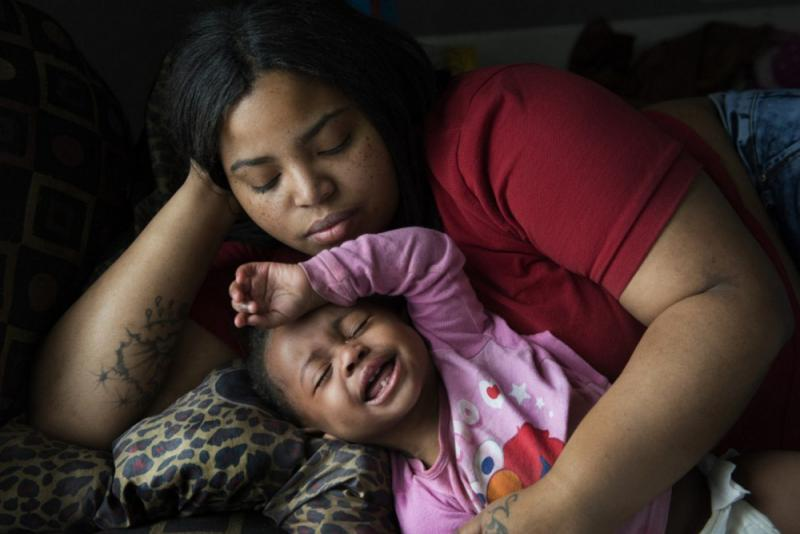 Nakeyja Cade with her year-old daughter Zariyah Cade in Flint, Mich., last March. The girl's blood had tested high for lead. A new study shows children with elevated blood-lead levels at age 11 ended up as adults with lower cognitive function than their parents. Washington Post photo by Linda Davidson
