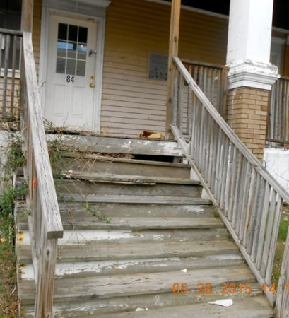 Photo of stairs with deteriorating paint.